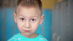 Looking into the camera boy with big eyes - stock footage