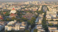 Canal transport at Golden mount with democracy monument,Bangkok,Thailand Stock Footage