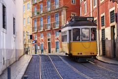 Vintage Lisbon tram on city street Stock Photos