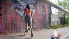 Writer painting a wall slide Stock Footage