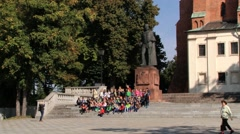 People make group photo next to the Gniezno Cathedral in Gniezno, Poland. Stock Footage