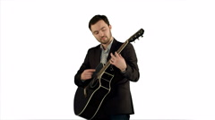 Young man playing guitar on white background isolated Stock Footage