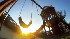 Empty swing silhouette move in playground at sunset, background loop Stock Footage