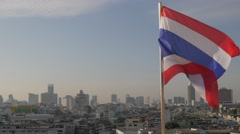 Thai flag blowing in wind with skyline,Bangkok,Thailand Stock Footage