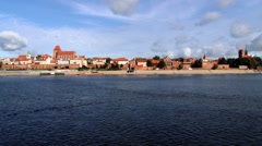 View to the medieval city across the Vistula river in Torun, Poland. Stock Footage
