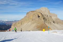 MADONNA DI CAMPIGLIO, ITALY - DECEMBER 18: The ski slope and skiers at Passo - stock photo