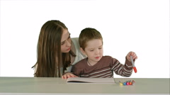 Happy family mother and child painting together on white background isolated Stock Footage