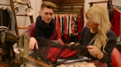Fashion designer and seamstress cutter discuss new collection Stock Footage
