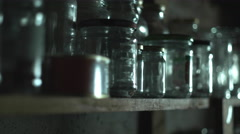Panning Shot of Glass Mason Jars in a Basement. Stock Footage
