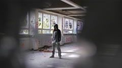 Writer standing in abandoned building Stock Footage