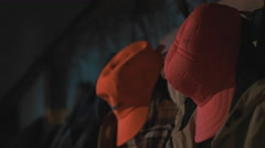 Orange Hunting Caps and Clothes. Stock Footage