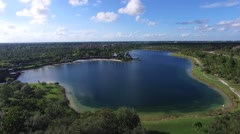 Aerial pan of Florida lake and horizon in summer - stock footage