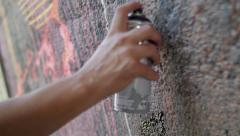Writer painting with spray can closeup Stock Footage