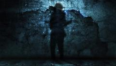 Shadow of Guitar Player Against Grunge Wall with Falling Debris - stock footage