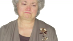 Mature woman fights back tears. - stock footage