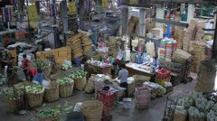 Busy market with vegetables in bamboo basket,Bangkok,Thailand Stock Footage