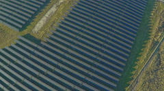 AERIAL industrial view Photovoltaic solar panels producing renewable energy - stock footage
