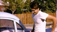 WILD HAPPY DANCE! Dancing MAN Washes Car 1960s Vintage Film Home Movie 9025 - stock footage