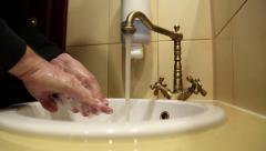 Man washes hands with soap - stock footage