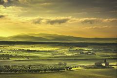 Tuscany Maremma foggy morning, farmland and green fields. Italy. Stock Photos