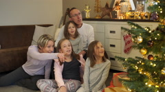 Family on christmas morning at home Stock Footage