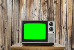 Vintage Television with Old Wood Wall and Chroma Screen - stock photo