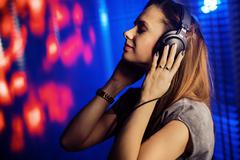 Relaxed woman listening to music Stock Photos