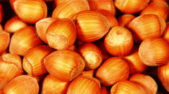 Looped: pile of shelled hazelnuts spinning slowly - stock footage