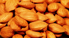 Looped: pile of almond nuts spinning slowly Stock Footage