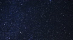 Astro Time Lapse of Constellation Orion over Desert Rocks -Zoom Out- - stock footage
