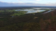 Long Drone Shot Of Lakes on plains coming off of Mountains Stock Footage