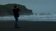 Woman with Binoculars Looks Over Rough Sea Stock Footage