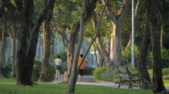 People jogging early morning in Chatuchak park,Bangkok,Thailand Stock Footage