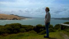 Woman Overlooks Senic NZ from Bluff Pan Stock Footage