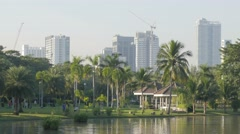 Chatuchak park with pond and skyline,Bangkok,Thailand Stock Footage
