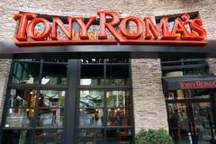 Tony Roma's Restaurant Exterior and Logo. Stock Photos