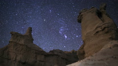 Stock Video Footage of 3axis Motion Control Time Lapse of Orion Stars over Desert Rocks -Zoom Out-