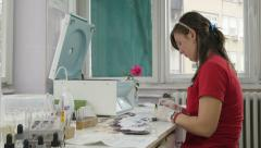 Female lab technician determining blood types in laboratory, blood sampling. - stock footage