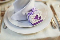Wedding banquet table with dishware and meal, waiting for bride and groom - stock photo