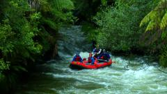 Red Raft in Rainforest River Stock Footage