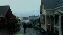 Man Walks Maori Village in Rain Stock Footage