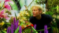 Woman and Orchad in Glasshouse Stock Footage