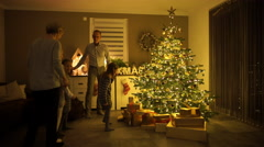 Father ringing christmas bell at home Stock Footage