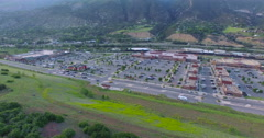 Aerial view of main street at local shopping center. Stock Footage