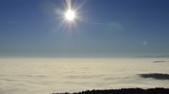 Amazing time-lapse scene of Mist movingover mountain range with sun goes down Stock Footage