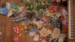 Overhead kids playing with new toys chrismas morning - stock footage