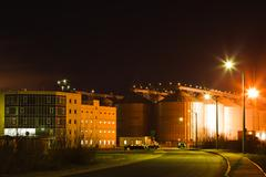 Stock Photo of Industrial building at night time