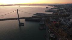 4K Aerial drone shot San Francisco above bay bridge forward sunrise Arkistovideo