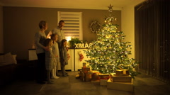 Family singing on christmas eve Stock Footage