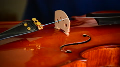 Luthier placing a string to a violin instrument in workplace Stock Footage